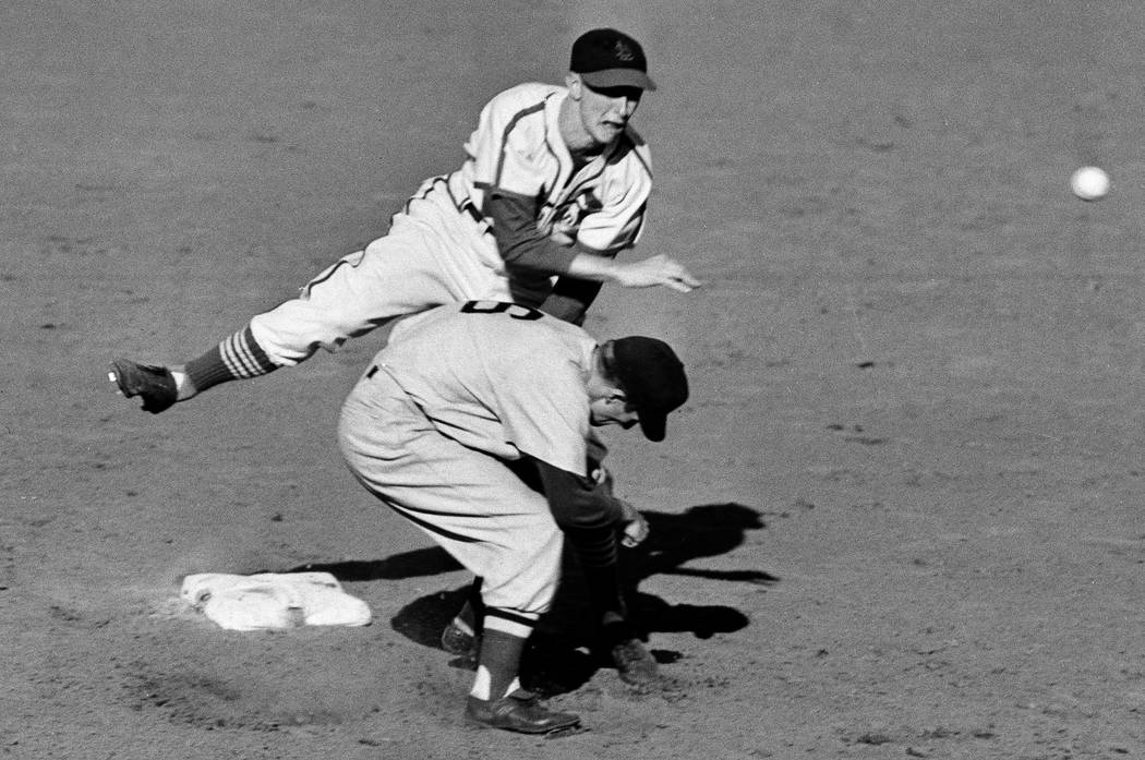 St. Louis Cardinals second baseman Red Schoendienst throws to first baseman Stan Musial after forcing Boston Red Sox shortstop Johnny Pesky during the sixth inning of the sixth game of the basebal ...