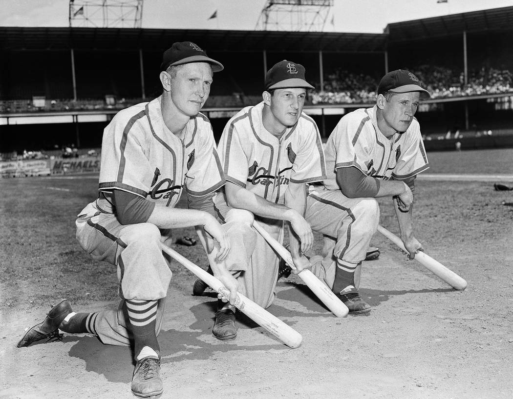 Three St. Louis Cardinals, Red Schoendienst, left, Stan Musial and Eddie Kazak, lean on their clubs at Ebbets Field in the Brooklyn borough of New York, June 1949. Schoendienst died Wednesday, Jun ...