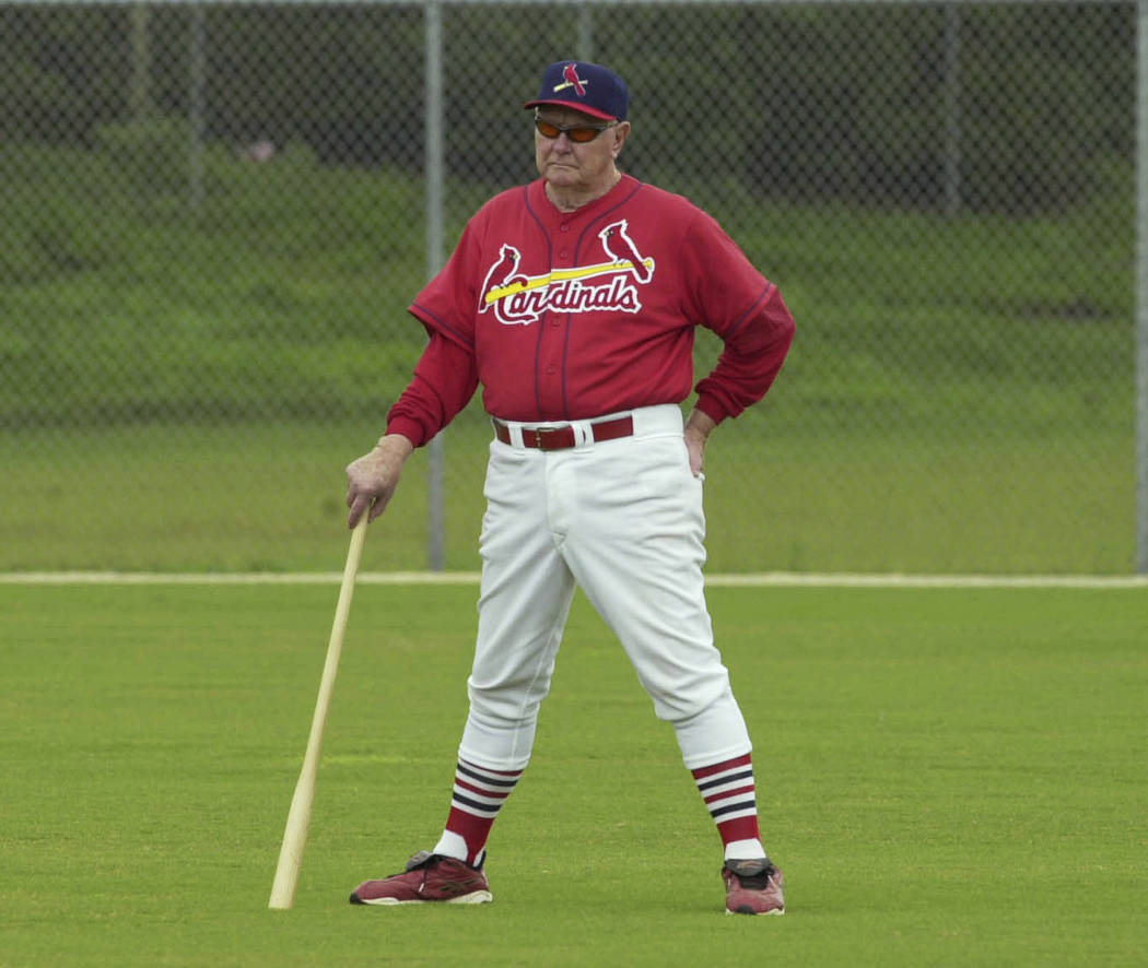Red Schoendienst stands in center field in Jupiter, Fla., with his fungo bat, watching practice for the St. Louis Cardinals during spring training, Feb. 21, 2002. Schoendienst died Wednesday, June ...