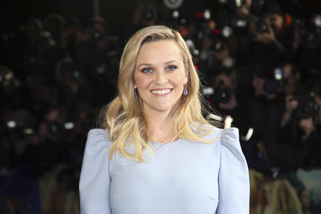 FILE - In this March 13, 2018, file photo, Actress Reese Witherspoon poses for photographers upon arrival at the premiere of the film 'A Wrinkle In Time' in London. Witherspoon confirms there will ...