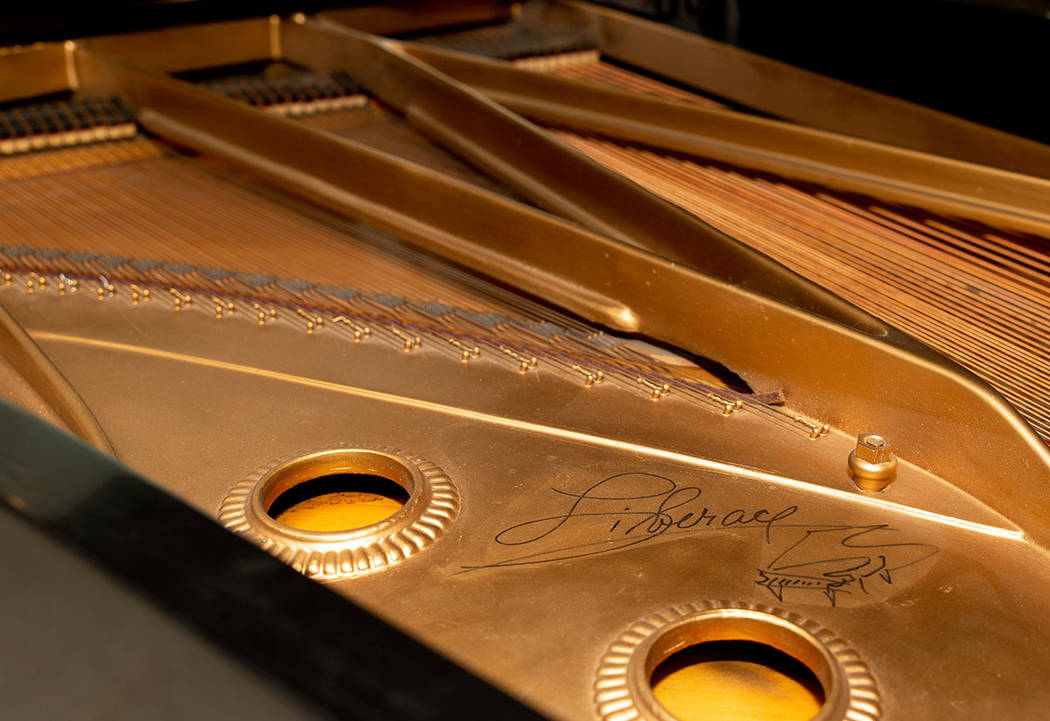 This piano is signed by Liberace. (Tonya Harvey Real Estate Millions)