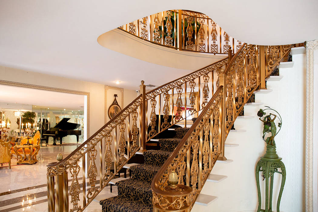 The famous grand entry staircase cost Liberace $75,000 to transport from Paris, France. (Tonya Harvey Real Estate Millions)