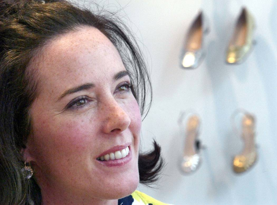 FILE - In this May 13, 2004 file photo, designer Kate Spade poses with shoes from her next collection in New York. Law enforcement officials say Tuesday, June 5, 2018, that New York fashion design ...