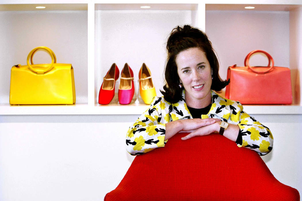 Kate Spade poses with handbags and shoes from her next collection in New York, Thursday May 13, 2004. (Bebeto Matthews/AP)