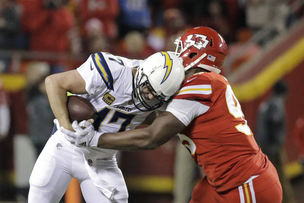 Kansas City Chiefs defensive lineman Chris Jones (95) sacks Los Angeles Chargers quarterback Philip Rivers (17) during the first half of an NFL football game in Kansas City, Mo., Saturday, Dec. 16 ...