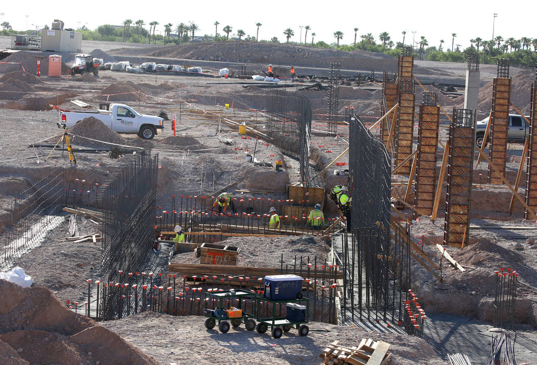 Construction workers lay down the footings and construct foundation walls at the construction site of the new Las Vegas ballpark on Thursday, June 7, 2018, in Summerlin. Bizuayehu Tesfaye/Las Vega ...