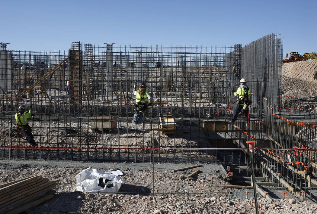 Construction workers are tying rebar to make a newly constructed footing frame at the construction site of the new Las Vegas ballpark on Thursday, June 7, 2018, in Summerlin. Bizuayehu Tesfaye/Las ...