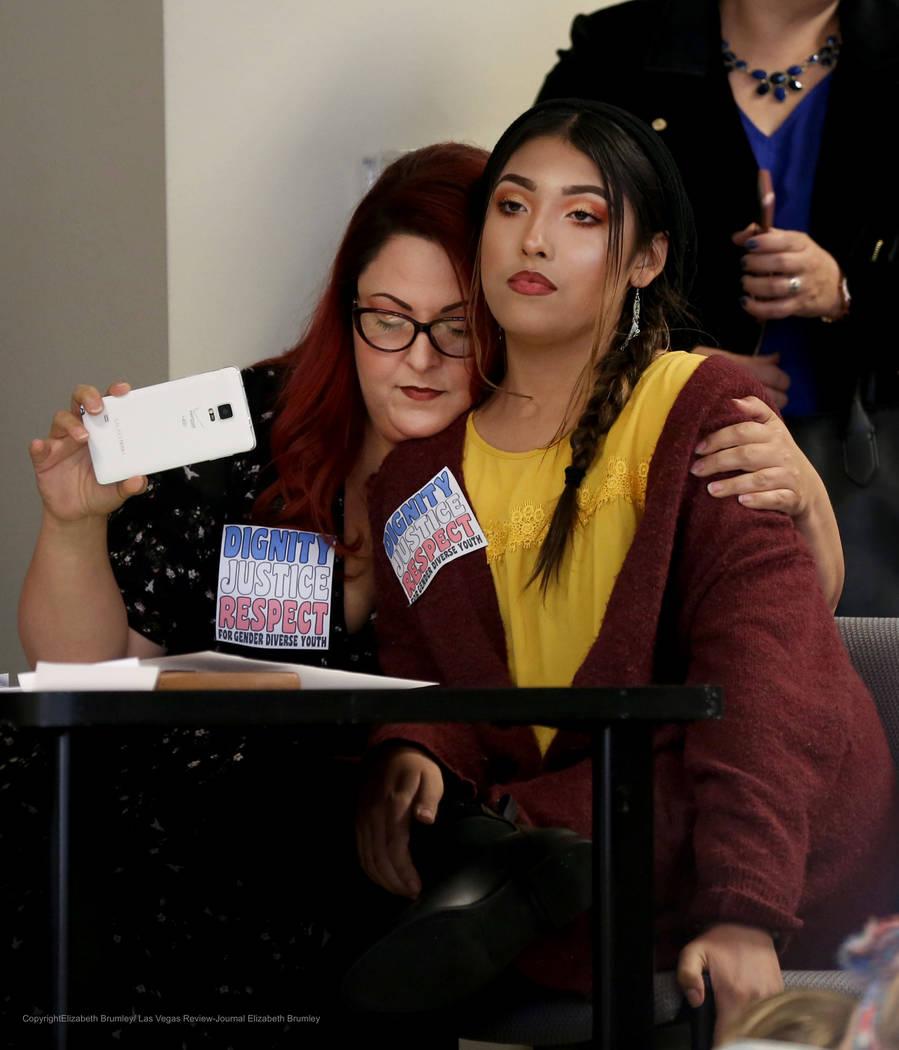 Family services coordinator for Gender Justice Nevada Laura Hernandez, left, hugs her transgender child Kristina Hernandez after they spoke during a meeting regarding transgender policies for the ...