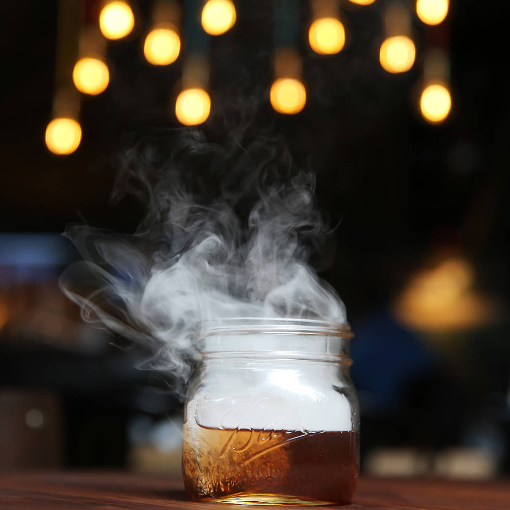 The Holy Smokes! cocktail, served with bourbon, maple, chocolate, and hickory smoke, at Eureka restaurant, 520 E. Fremont St., in Las Vegas, Wednesday, June 13, 2018. Erik Verduzco Las Vegas Revie ...