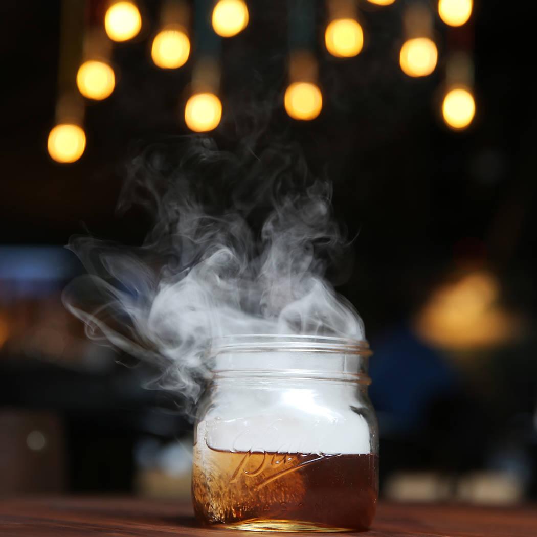 The Holy Smokes! cocktail, served with bourbon, maple, chocolate, and hickory smoke, at Eureka restaurant, 520 E. Fremont St., in Las Vegas, Wednesday, June 13, 2018. Erik Verduzco Las Vegas Revie ...