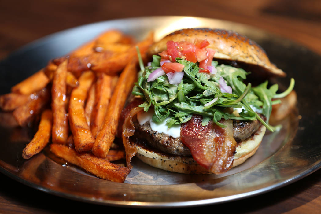 The Fresno Fig Burger, served with fig marmalade, melted goat cheese, bacon, tomato, red onion, arugula, and spicy porter mustard, at Eureka restaurant, 520 E. Fremont St., in Las Vegas, Wednesday ...