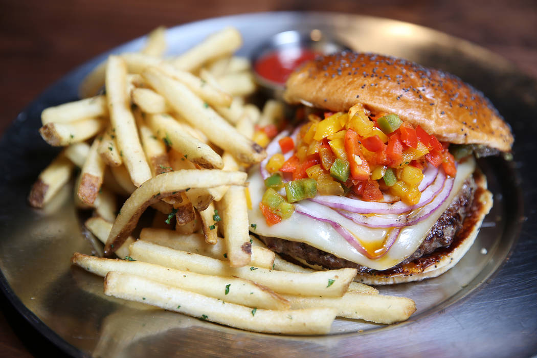 The Bison Burger, served with bacon-infused jalapeño jam, charbroiled tricolor piers, grilled red onions, and smoked mozzarella, at Eureka restaurant, 520 E. Fremont St., in Las Vegas, Wednes ...