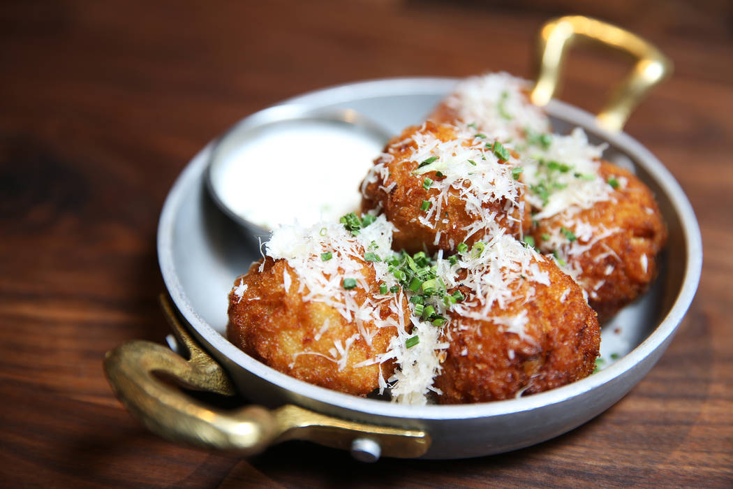 The Mc N' Cheese Balls, served with beer cheese sauce, Fresno chiles, chives and parmesan cheese, at Eureka restaurant, 520 E. Fremont St., in Las Vegas, Wednesday, June 13, 2018. Erik Verduzco La ...