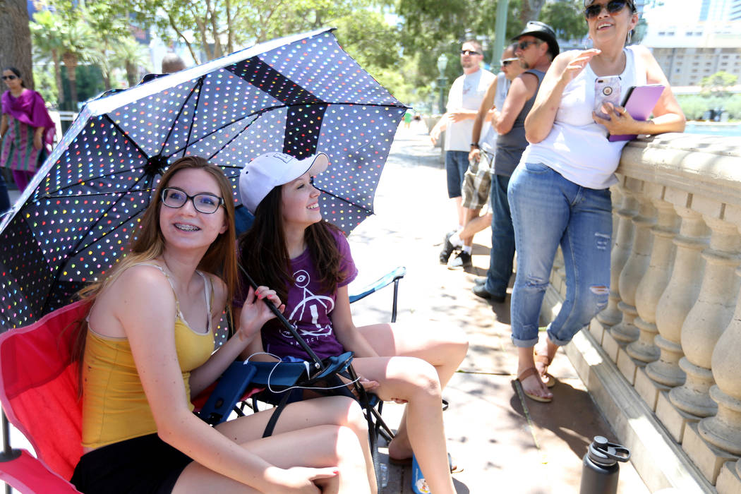 Fans, from left, Caitlyn Richardson, 15, Tori Coates, 15 and Tori's mom, Debby Coates, wait to watch the Las Vegas rock band Panic! at the Disco perform at the Fountains at Bellagio ahead of the V ...