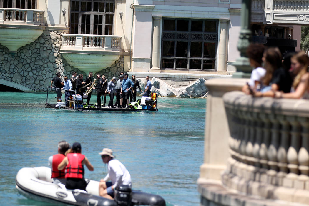Members of the Las Vegas rock band Panic! at the Disco take a boat ride to the stage before performing at the Fountains at Bellagio ahead of the Vegas Golden Knights-Washington Capitals NHL hockey ...