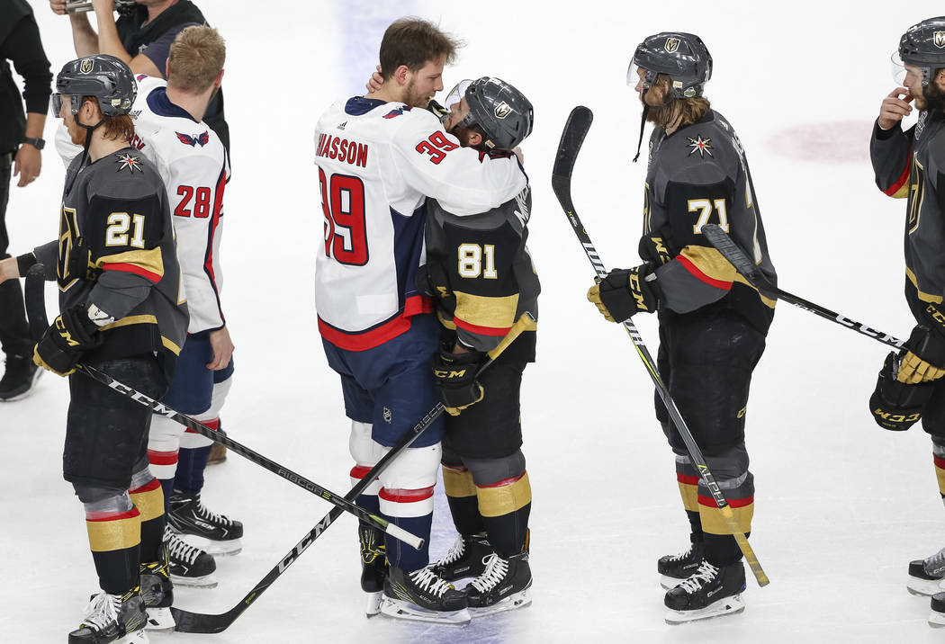 Washington Capitals right wing Alex Chiasson (39) and Vegas Golden Knights center Jonathan Marchessault (81) share a hug after the Capitals defeated the Knights 4-3 to win the NHL hockey Stanley C ...