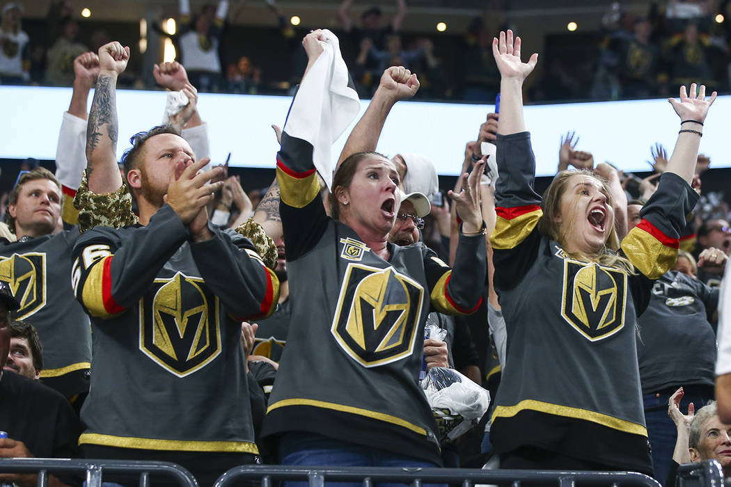 Golden Knights fans celebrate a goal by Golden Knights left wing David Perron, not pictured, during the second period of Game 5 of the Stanley Cup Final against the Washington Capitals at T-Mobile ...