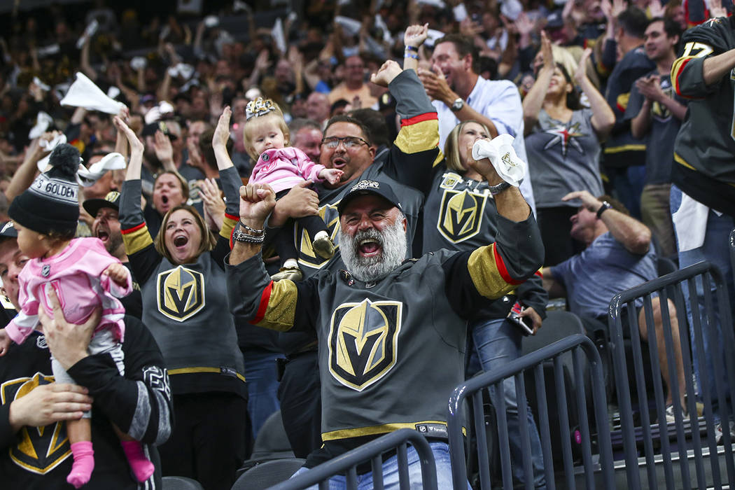 Golden Knights fans celebrate a goal by defenseman Nate Schmidt, not pictured, during the second period of Game 5 of the Stanley Cup Final against the Washington Capitals at T-Mobile Arena in Las ...