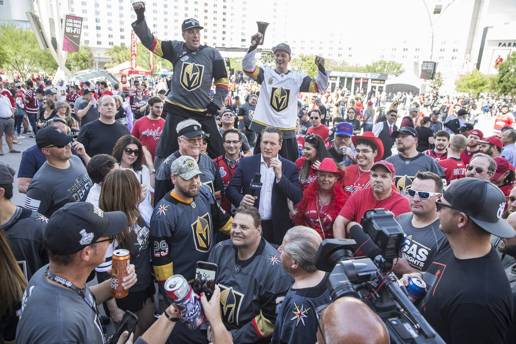 Golden Knights fans surround former NHL star and current NBC analyst Jeremy Roenick outside T-Mobile Arena before the start of Game 5 of the NHL Stanley Cup Final against the Washington Capitals o ...