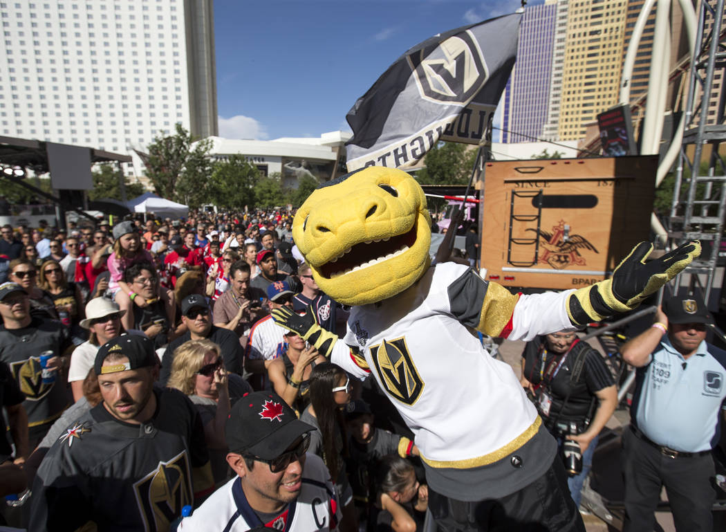 The Vegas Golden Knights mascot Chance the Golden Gila Monster during the march to the fortress ahead of Game 5 of the NHL hockey Stanley Cup Final outside T-Mobile Arena in Las Vegas on Thursday, ...
