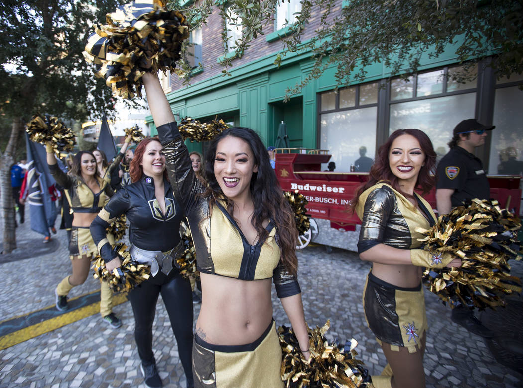 A member of the Vegas Golden aces waives to fans during the march to the fortress ahead of Game 5 of the NHL hockey Stanley Cup Final outside T-Mobile Arena in Las Vegas on Thursday, June 7, 2018. ...