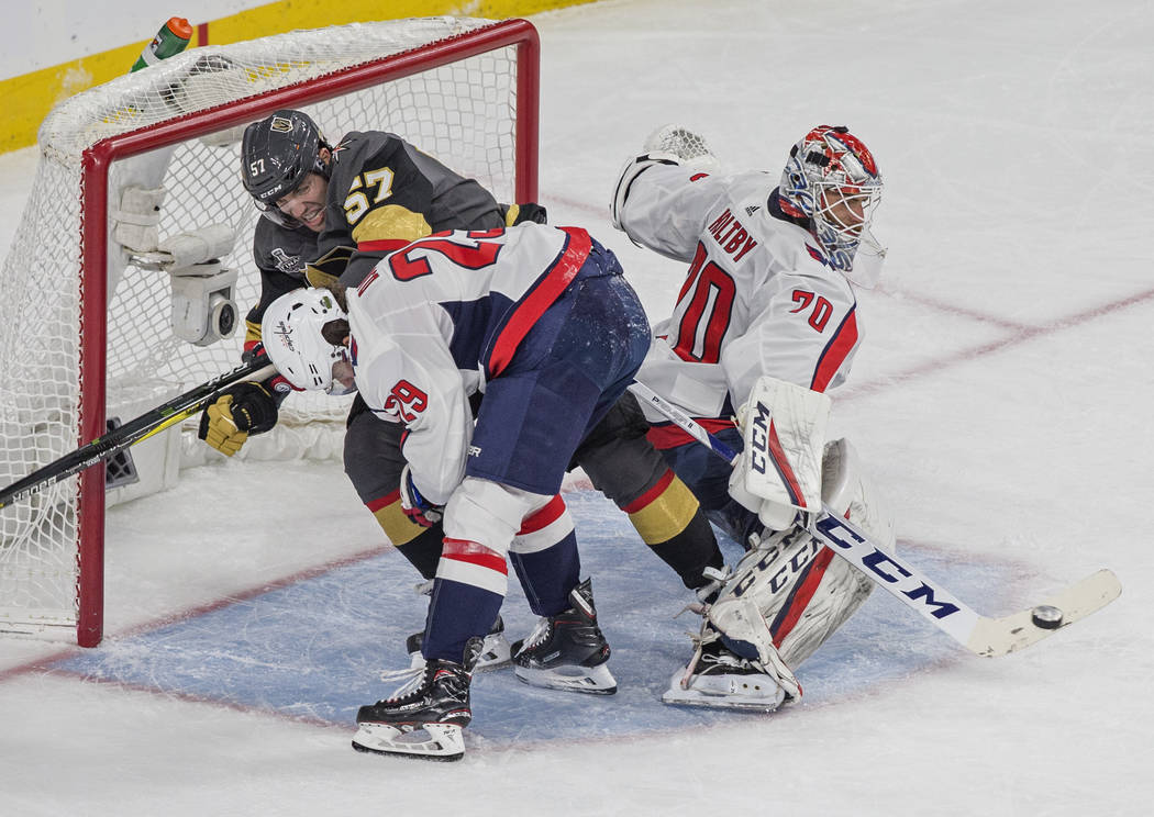 Golden Knights left wing David Perron's (57) shot gets past Capitals goaltender Braden Holtby (70) and defenseman Christian Djoos (29) in the second period during Game 5 of the NHL Stanley Cup Fin ...