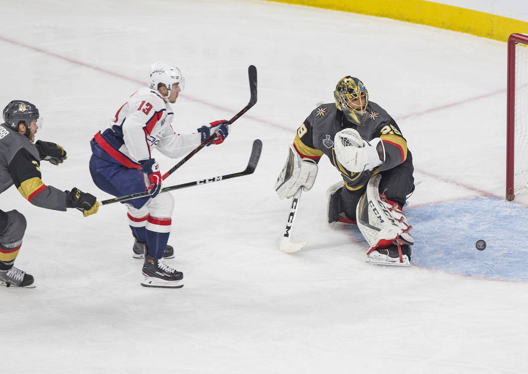 Capitals left wing Jakub Vrana (13) scores a second-period goal against Golden Knights goaltender Marc-Andre Fleury (29) during Game 5 of the NHL Stanley Cup Final on Thursday, June 7, 2018, at T ...