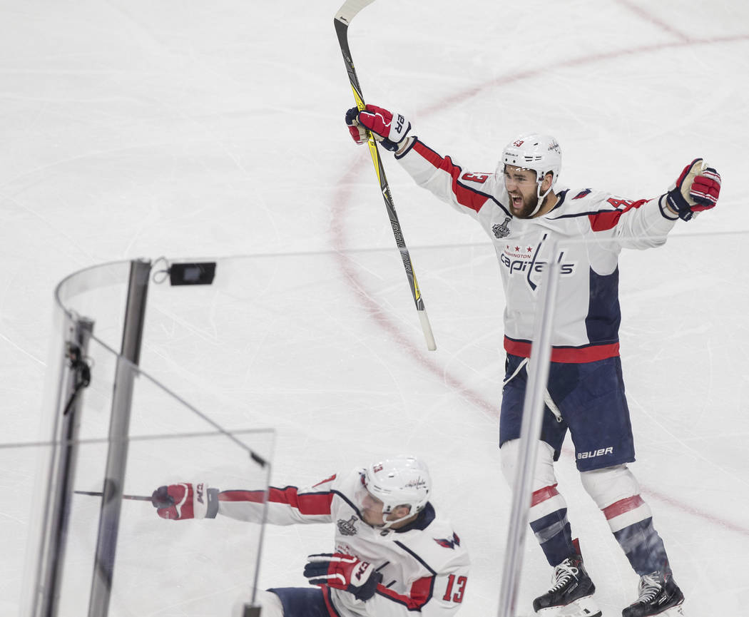 Capitals right wing Tom Wilson (43) and left wing Jakub Vrana (13) celebrate after Vrana scored a second-period goal during Game 5 of the NHL Stanley Cup Final against the Golden Knights on Thurs ...