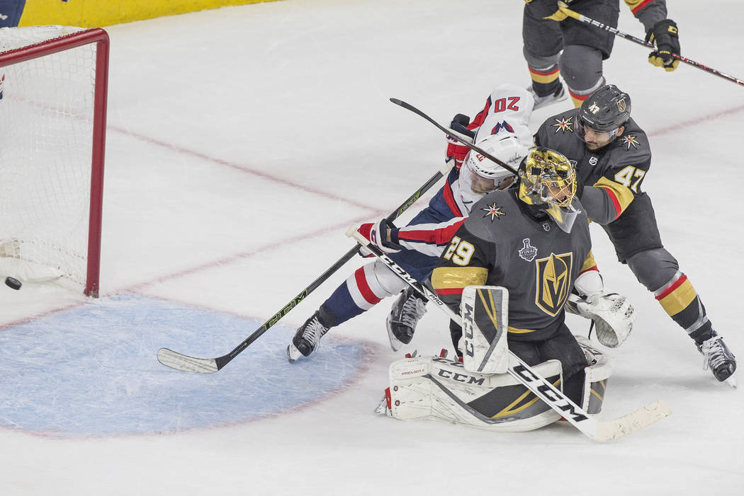Capitals center Lars Eller (20) scores a third-period goal past Golden Knights defenseman Luca Sbisa (47) and goaltender Marc-Andre Fleury (29) during Game 5 of the NHL Stanley Cup Final on Thurs ...