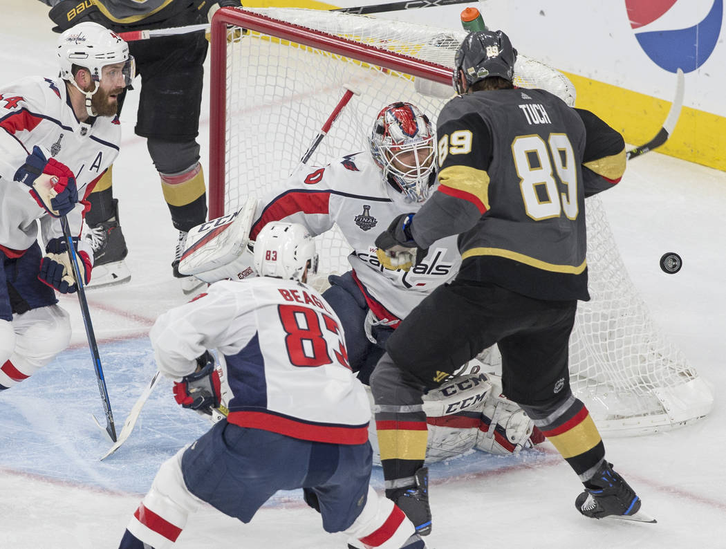 Capitals goaltender Braden Holtby (70) makes a third-period save against Golden Knights right wing Alex Tuch (89) during Game 5 of the NHL Stanley Cup Final on Thursday, June 7, 2018, at T-Mobile ...