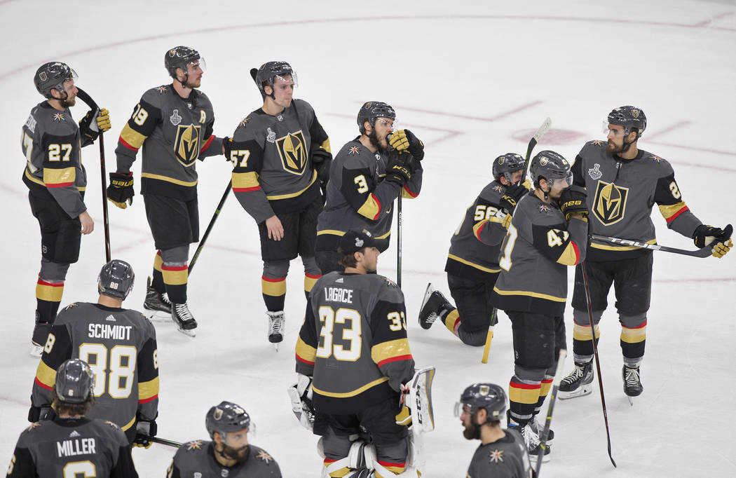 The Golden Knights watch the Capitals celebrate after Vegas lost to Washington 4-3 during Game 5 of the NHL Stanley Cup Final on Thursday, June 7, 2018, at T-Mobile Arena, in Las Vegas. Benjamin H ...