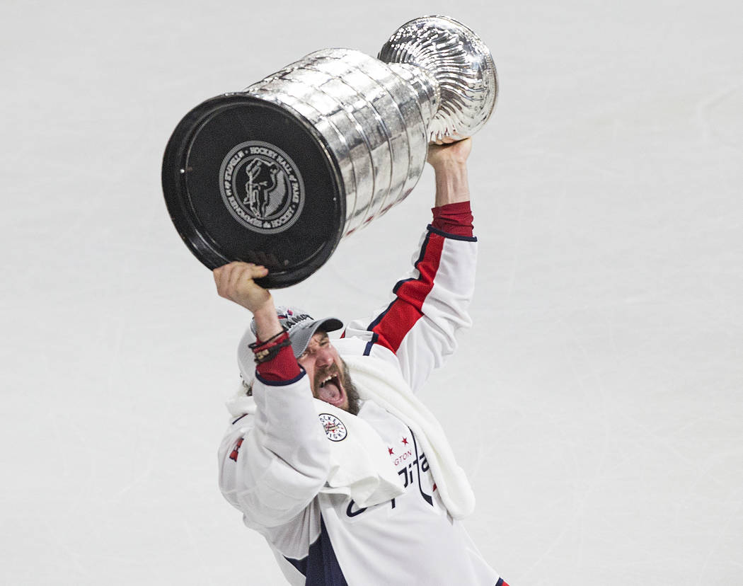 Capitals left wing Alex Ovechkin (8) raises the Stanley Cup after Washington beat the Golden Knights 4-3 in Game 5 of the NHL Stanley Cup Final on Thursday, June 7, 2018, at T-Mobile Arena, in Las ...