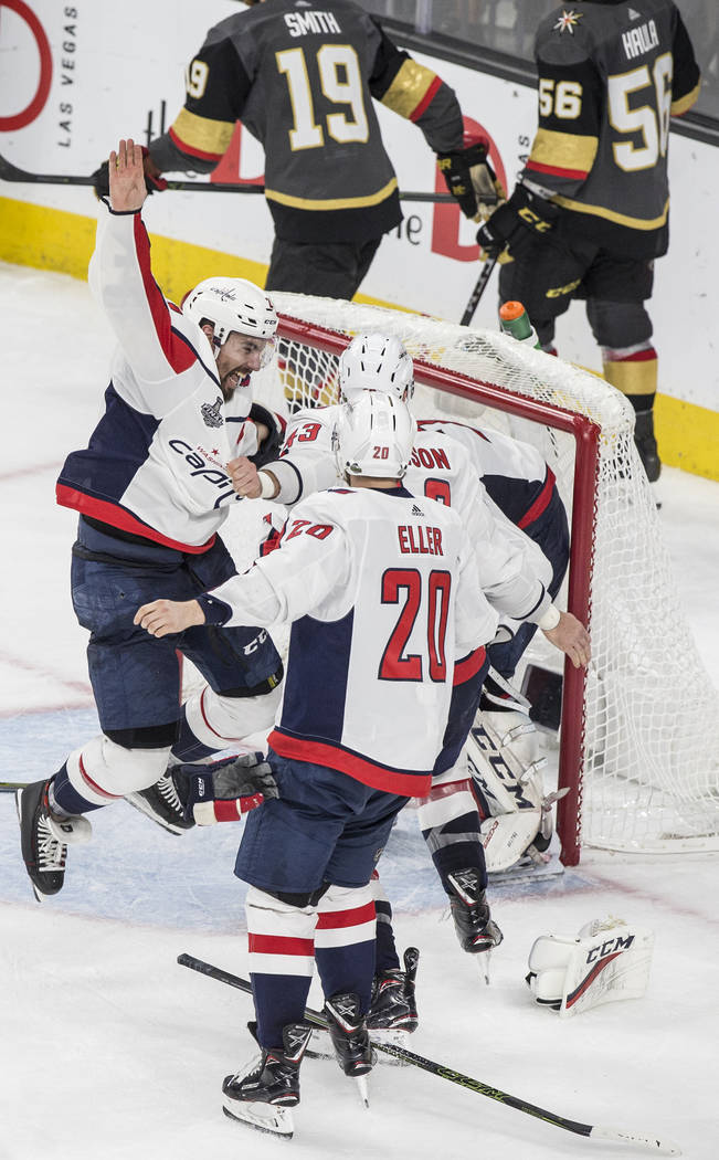 The Washington Capitals celebrate after beating the Golden Knights 4-3 in Game 5 of the NHL Stanley Cup Final on Thursday, June 7, 2018, at T-Mobile Arena, in Las Vegas. Benjamin Hager Las Vegas R ...