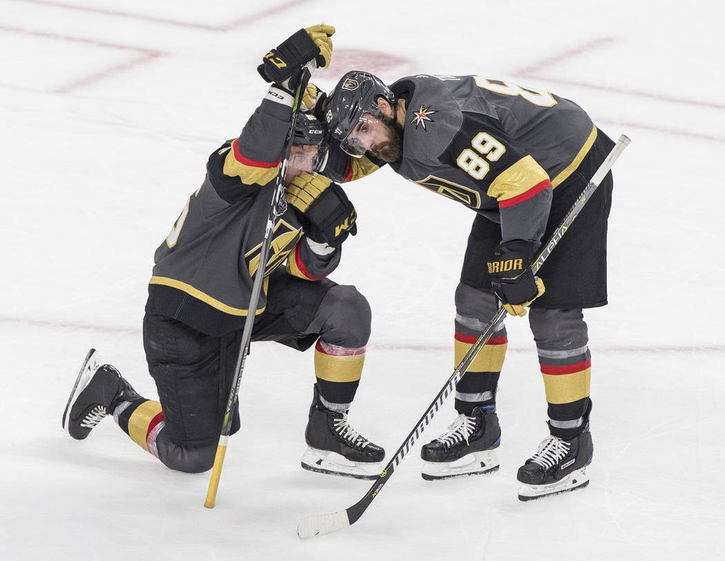 Golden Knights right wing Alex Tuch (89) consoles left wing Erik Haula (56) after losing to the Washington Capitals 4-3 during Game 5 of the NHL Stanley Cup Final on Thursday, June 7, 2018, at T-M ...