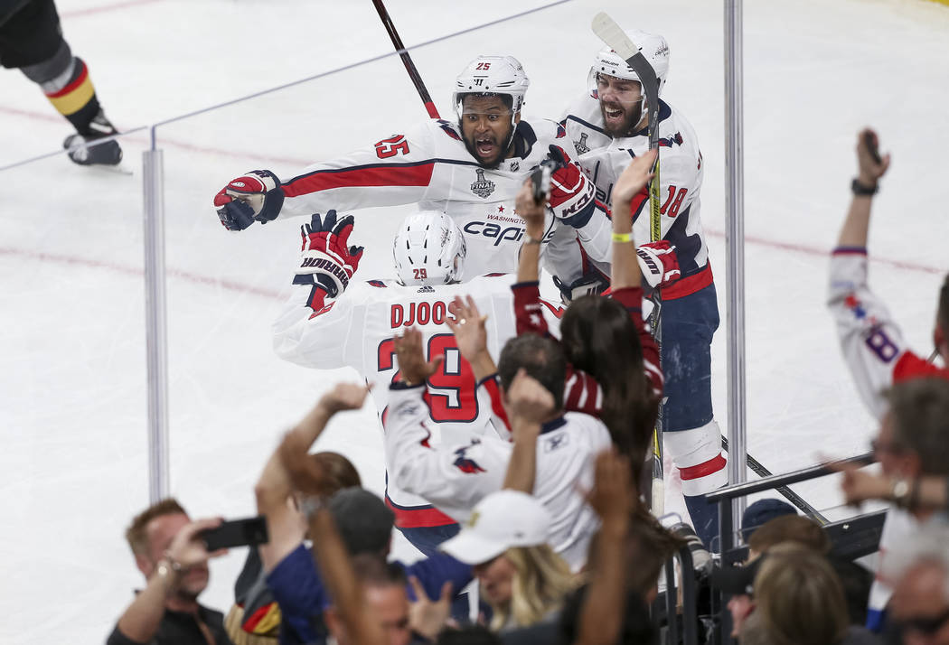 Washington Capitals defenseman Christian Djoos (29), right wing Devante Smith-Pelly (25) and center Chandler Stephenson (18) celebrate Smith-Pelly's third period goal against the Vegas Golden Knig ...
