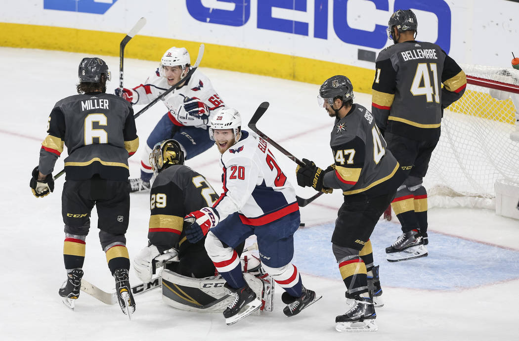 Washington Capitals center Lars Eller (20) and Capitals left wing Andre Burakovsky (65) celebrate Eller's third period goal against the Vegas Golden Knights in Game 5 of the NHL hockey Stanley Cup ...