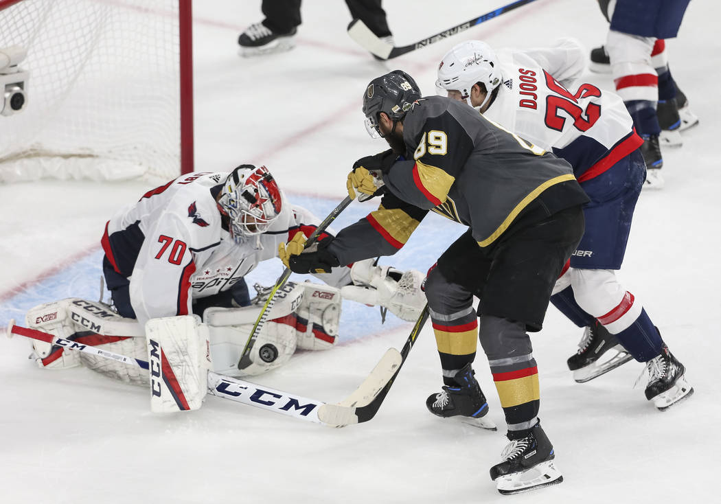 Washington Capitals goaltender Braden Holtby (70) blocks an attempt by Golden Knights right wing Alex Tuch (89) as Capitals defenseman Christian Djoos (29) defends during the third period of Game ...