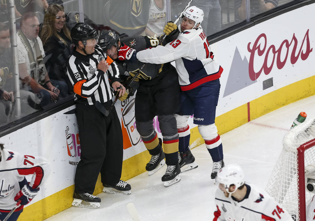 Vegas Golden Knights left wing Tomas Nosek (92) gets punched by Washington Capitals left wing Jakub Vrana (13) during the third period of Game 5 of the NHL hockey Stanley Cup Final at T-Mobile Are ...