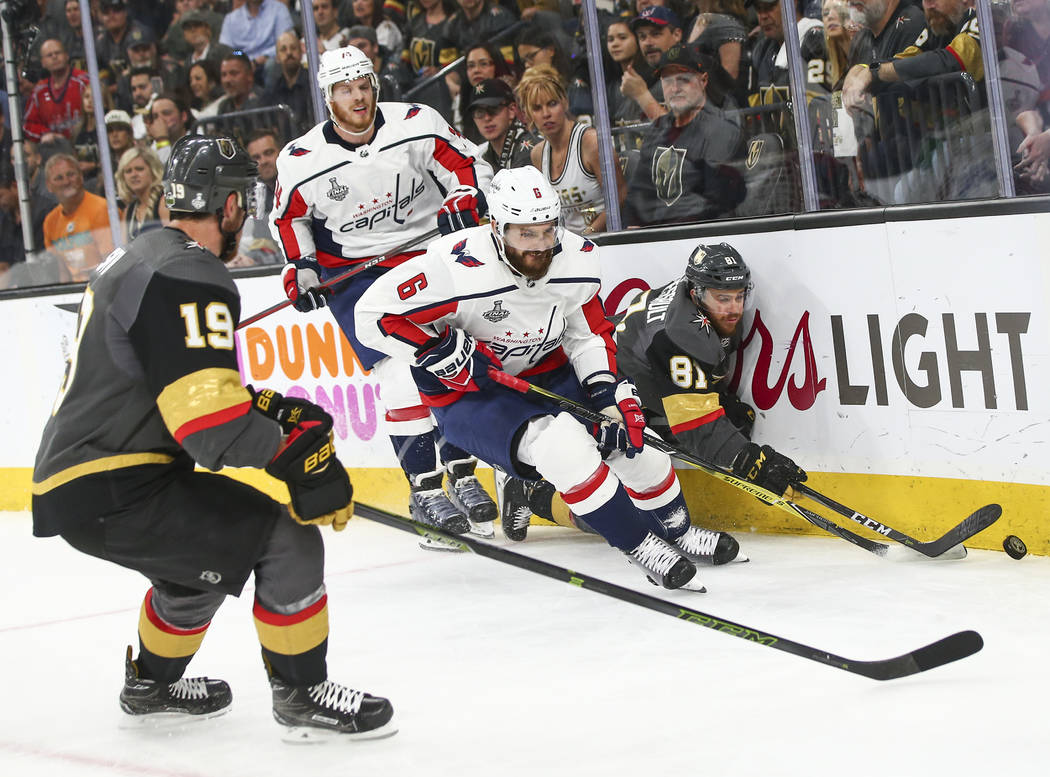 Golden Knights center Jonathan Marchessault (81) and Washington Capitals defenseman Michal Kempny (6) battle for the puck in front of Golden Knights right wing Reilly Smith (19) during the first p ...