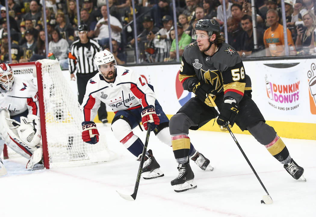 Golden Knights left wing Erik Haula (56) moves the puck against Washington Capitals defenseman Matt Niskanen (2) during the first period of Game 5 of the Stanley Cup Final at T-Mobile Arena in Las ...