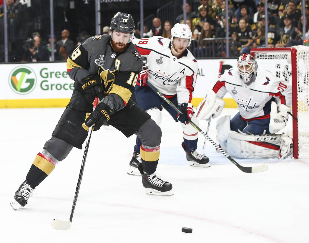 Golden Knights left wing James Neal (18) goes for the puck in front of Washington Capitals center Nicklas Backstrom (19) during the first period of Game 5 of the Stanley Cup Final at T-Mobile Aren ...