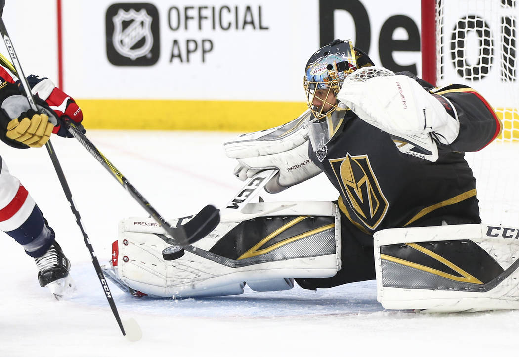 Golden Knights goaltender Marc-Andre Fleury (29) blocks a shot from the Washington Capitals during the second period of Game 5 of the Stanley Cup Final at T-Mobile Arena in Las Vegas on Thursday, ...