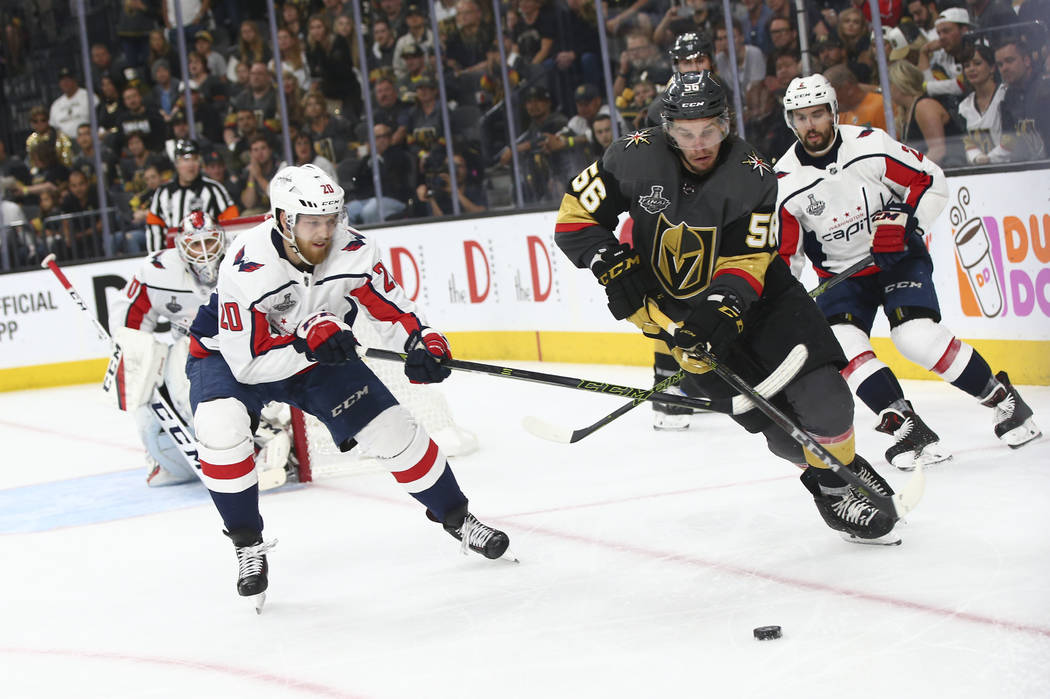 Golden Knights left wing Erik Haula (56) moves the puck against Washington Capitals center Lars Eller (20) during the third period of Game 5 of the Stanley Cup Final at T-Mobile Arena in Las Vegas ...