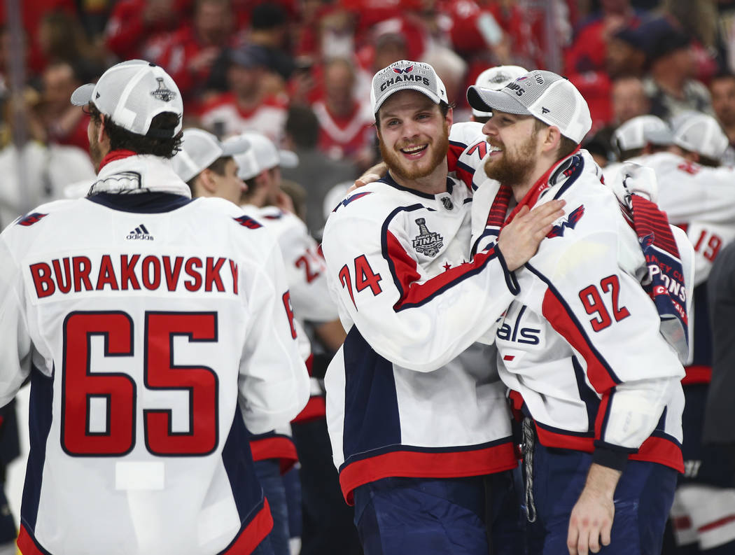 Washington Capitals defenseman John Carlson (74) and Washington Capitals center Evgeny Kuznetsov (92) celebrate after defeating the Golden Knights in Game 5 to win the Stanley Cup Final at T-Mobil ...