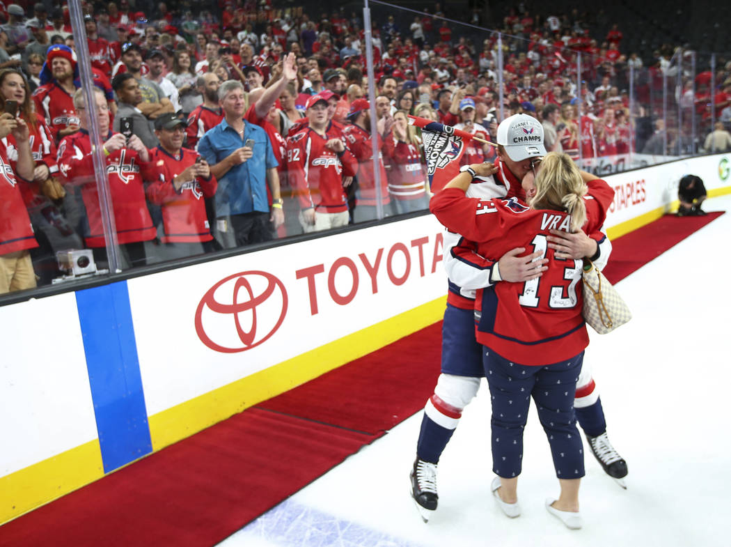 Washington Capitals left wing Jakub Vrana (13) celebrates with a loved one after defeating the Golden Knights in Game 5 to win the Stanley Cup Final at T-Mobile Arena in Las Vegas on Thursday, Jun ...