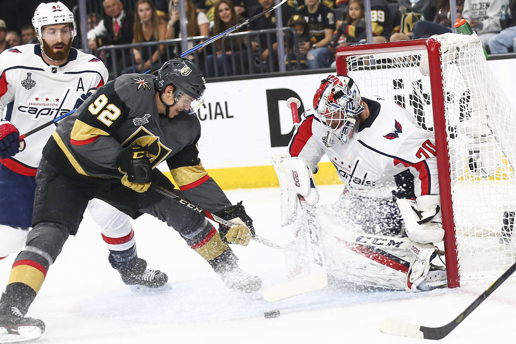 Golden Knights left wing Tomas Nosek (92) tries to get the puck in against Washington Capitals goaltender Braden Holtby (70) during the first period of Game 5 of the Stanley Cup Final at T-Mobile ...