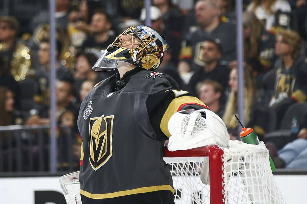 Golden Knights goaltender Marc-Andre Fleury (29) reacts after getting  scored against by fbb224262b5