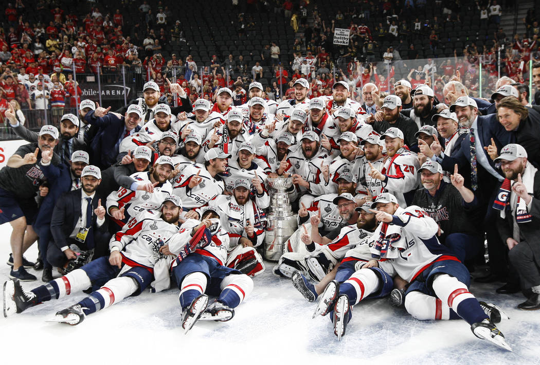 Washington Capitals players celebrate after defeating the Golden Knights in Game 5 to win the Stanley Cup Final at T-Mobile Arena in Las Vegas on Thursday, June 7, 2018. Chase Stevens Las Vegas Re ...