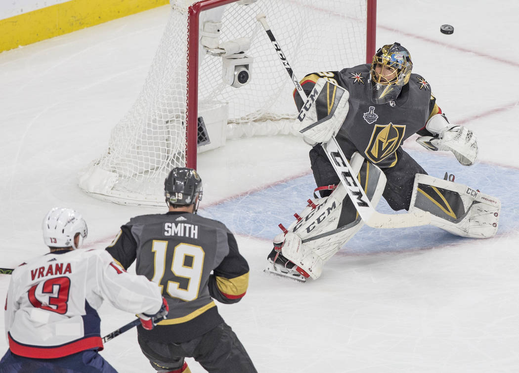 Golden Knights goaltender Marc-Andre Fleury (29) makes a save in the first period during Game 5 of the NHL Stanley Cup Final against the Washington Capitals on Thursday, June 7, 2018, at T-Mobile ...