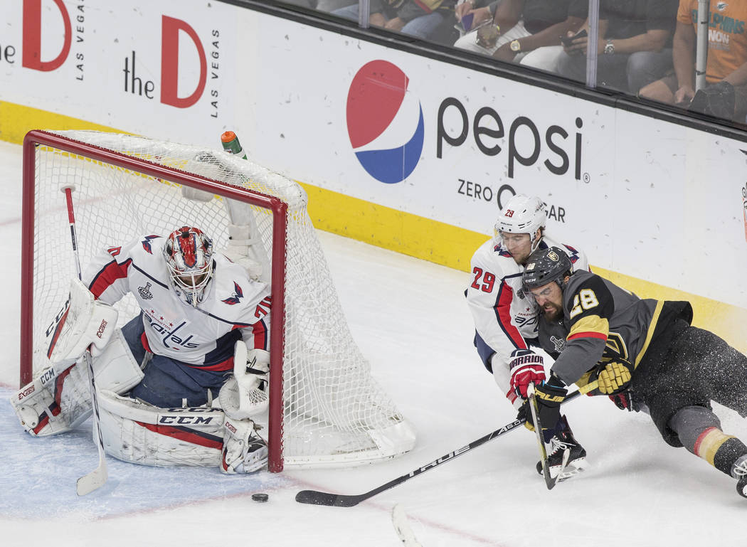 Golden Knights left wing William Carrier (28) beats Capitals defenseman Christian Djoos (29) and shoots on goaltender Braden Holtby (70) in the first period during Game 5 of the NHL Stanley Cup Fi ...